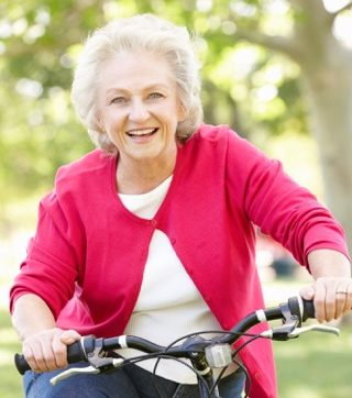 elderly woman riding a bicycle.