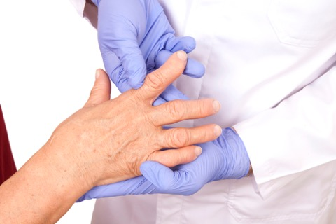 Doctor examining a hand.
