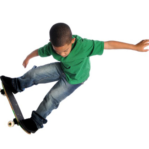 Child doing a trick on a skateboard.