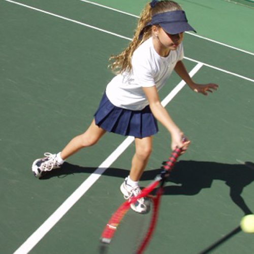 young girl playing tennis.