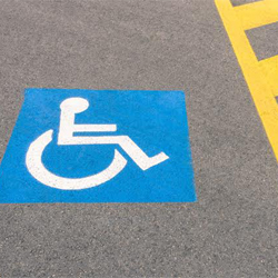 Handicap parking on spot in parking lot.