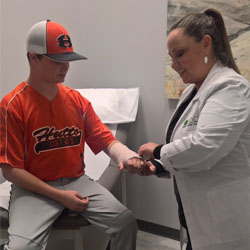 Doctor treating an athlete patient.