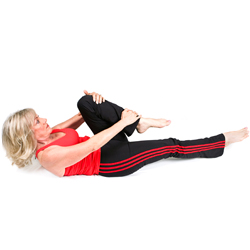 woman doing a stretch to relieve back pain.