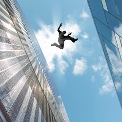 Man jumping from one top of building to another.
