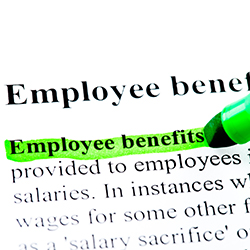 "The words ""employee benefits"" being highlighted on a sheet of paper."