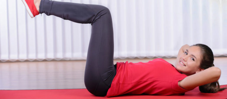 woman doing a trunk rotation stretch.