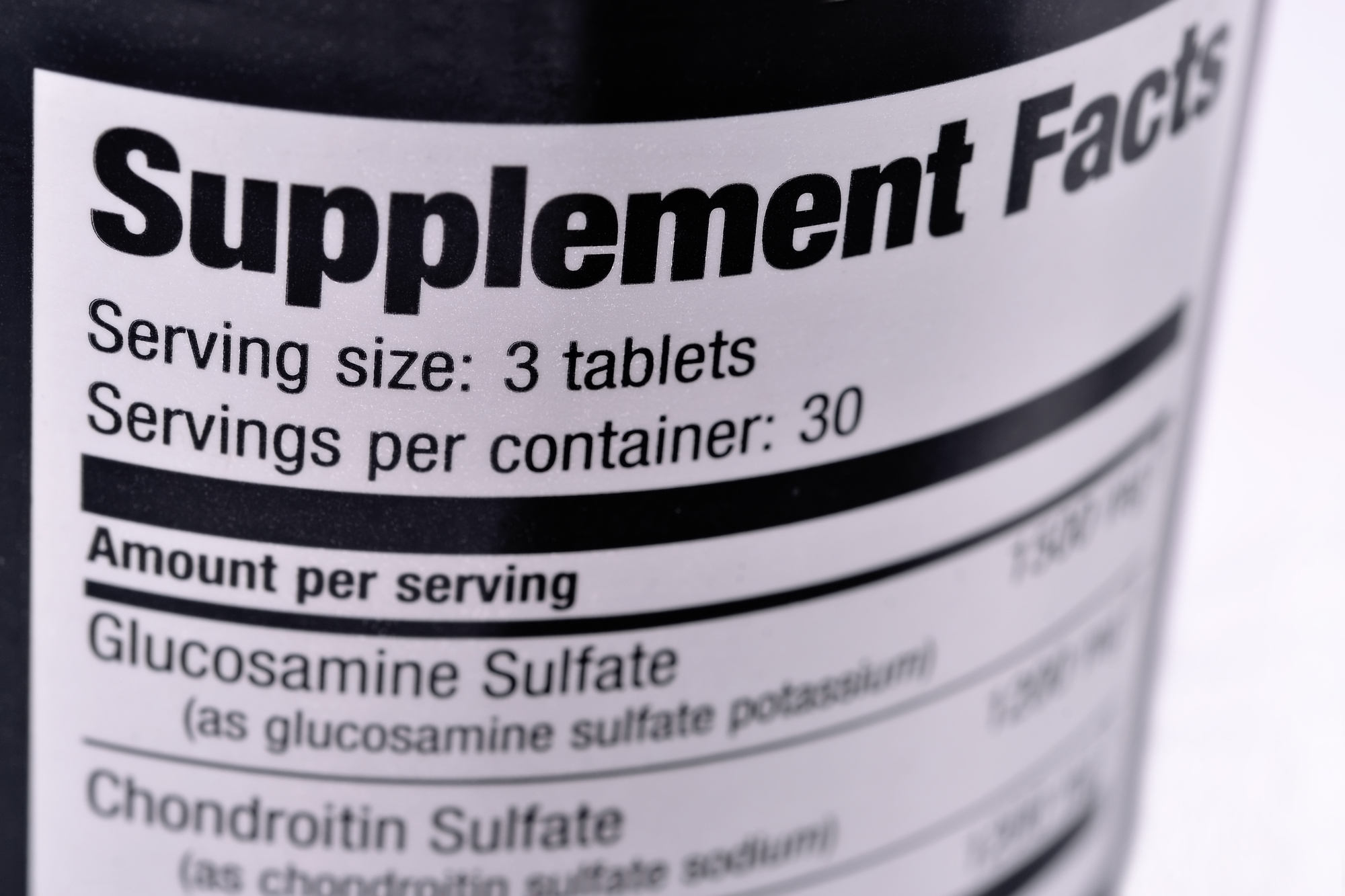 Closeup of a bottle of nutritional supplements.