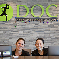 photo of two DOC receptionists.