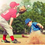 Baseball player sliding into second base