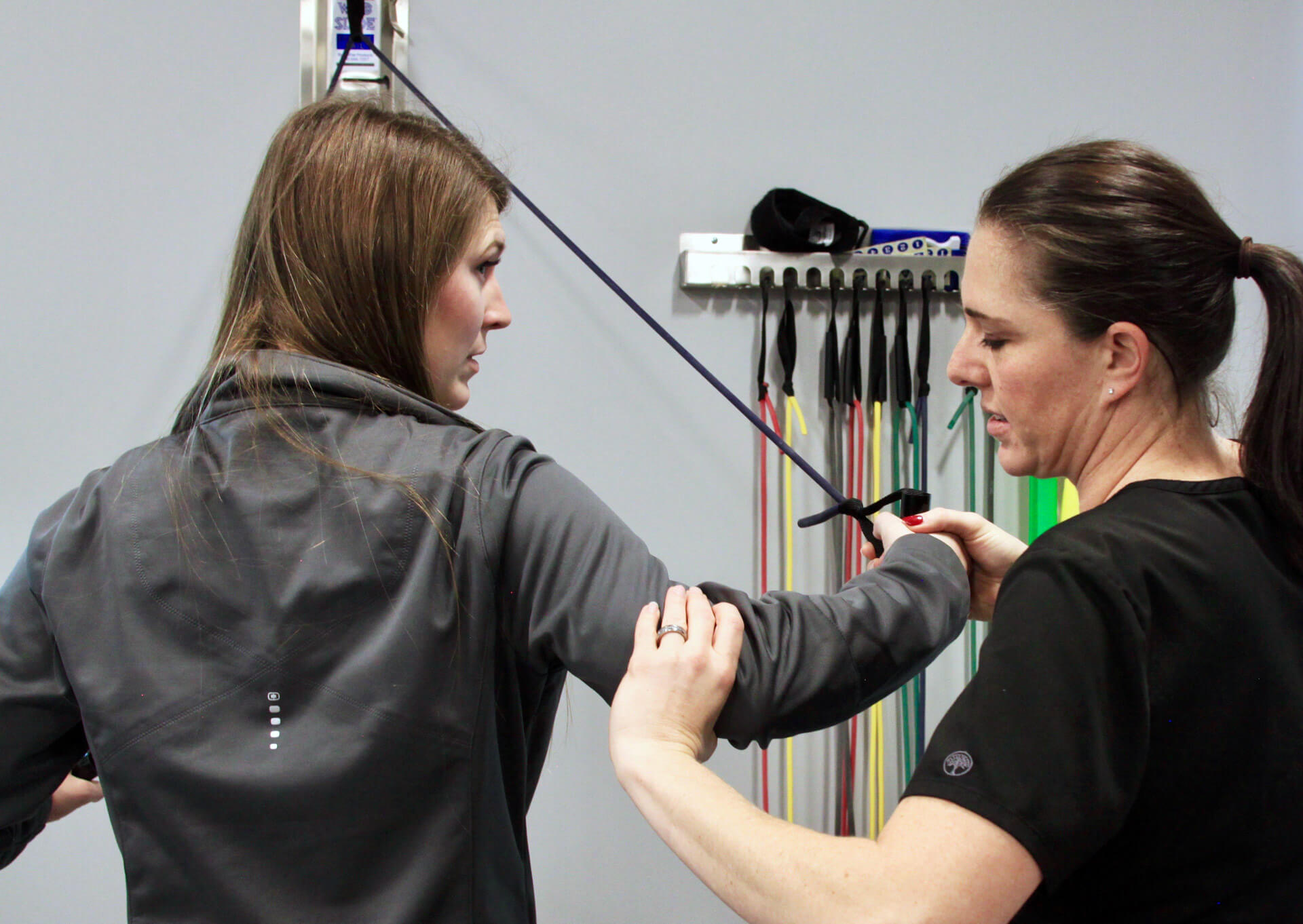 Physical therapist works through conventional therapy exercises with patient.