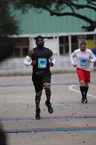 Adam participating in a race.