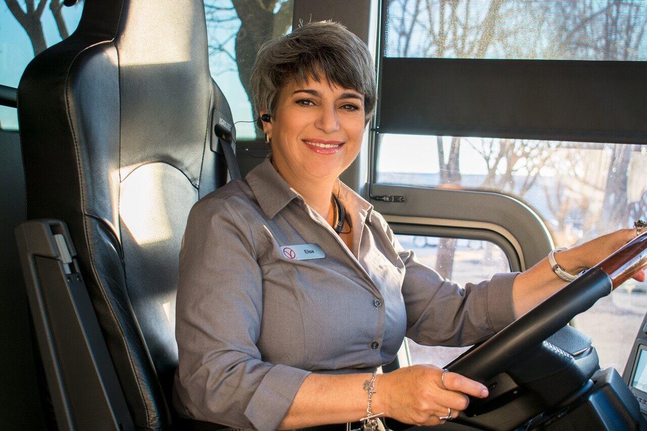 Elisa Morales driving a motor coach.