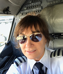 Selfie of Karen in the cockpit of a plane.