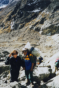 Nancy and her partner hiking in a rocky area.