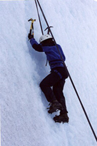 Man climbing an icy cliff.
