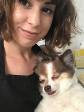 Selfie of Angie with her dog.