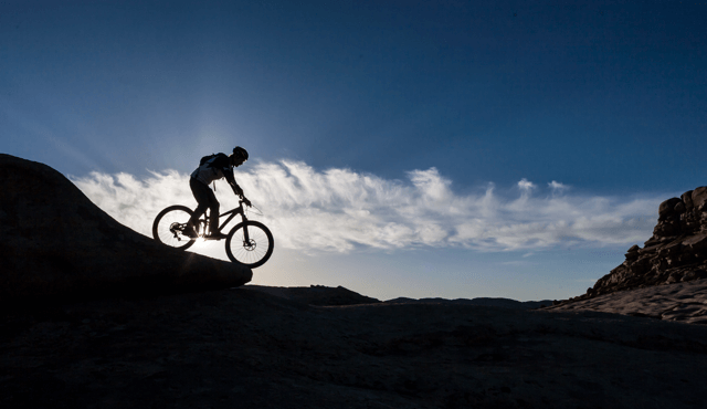 Silhouette of bicyclist.