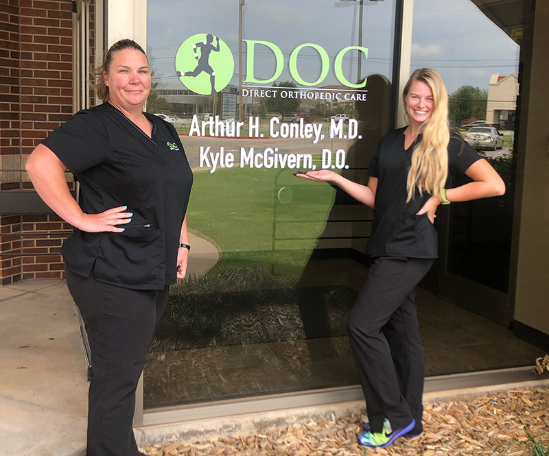 Two DOC team members stand outside of the Oklahoma City clinic location.