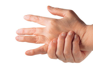 Person grabbing hand from rheumatoid arthritis pain.