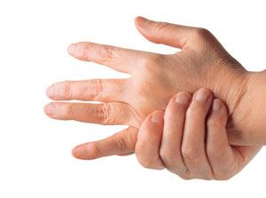 Person grabbing hand from rheumatoid arthritis pain.