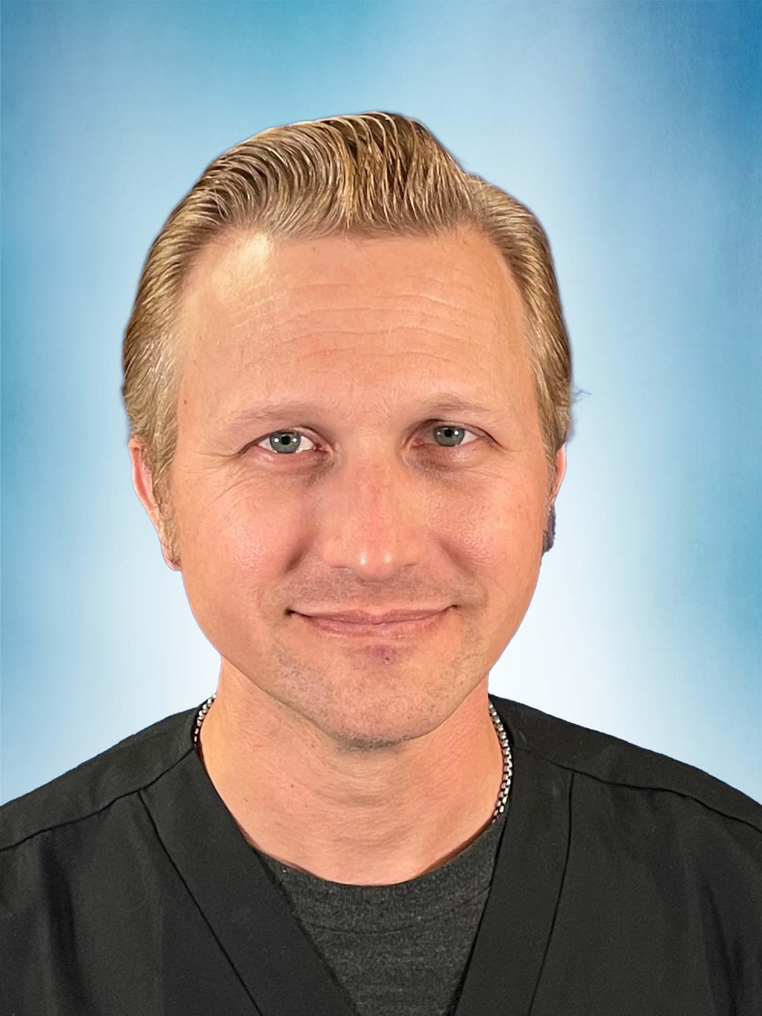 Headshot of Russell Wilson, MS, PA-C, ATC.